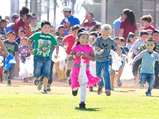 A group of area children race at Maag Field.