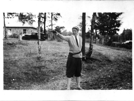Eleanor Roosevelt practicing with her pistol at Chazy Lake, N.Y., in 1934.