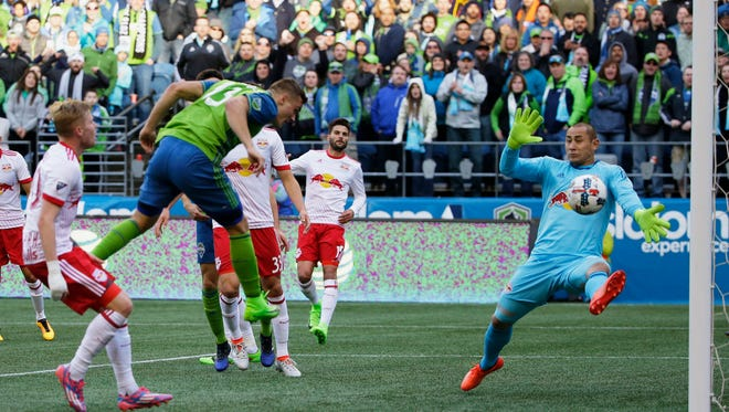 Sounders forward Jordan Morris scores what proved to be the winning goal, beating New York Red Bulls goalkeeper Luis Robles with a header Sunday at CenturyLink Field. Seattle won, 3-1.