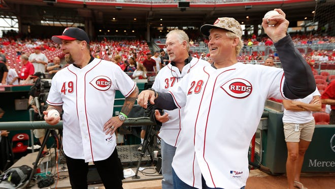 Former Reds pitchers Rob Dibble (from left), Norm Charlton and Randy Myers were known as The Nasty Boys in 1990, when they played a big part in the Reds winning the World Series. The trio helped throw out last season's ceremonial first pitches and this year will be Grand Marshals at the Opening Day Parade.