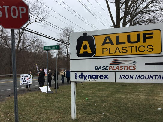 Residents rally outside of Aluf Plastics on March 5.