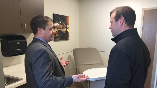 Fairfield Medical Center plant engineering manager Chad Cupp (left) discusses the hospital's new medical office in Amanda Wednesday with FMC physician Andrew Twehues.