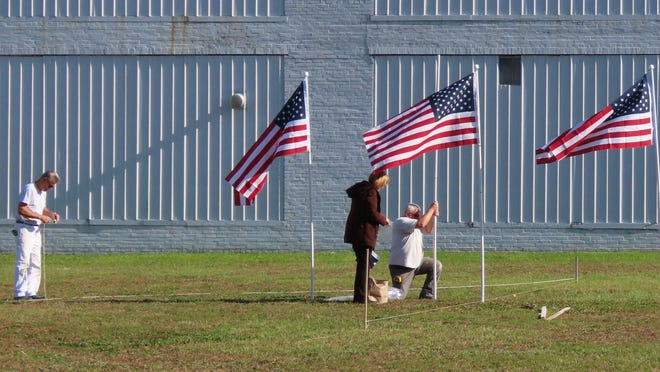 The Port Jervis Rotary Club has begun placing flags in the Field of Heroes.