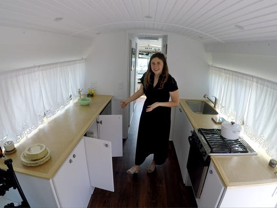Jessie Lipskin gives a tour Monday, June 25, 2018, of her former 1966 Greyhound bus that was converted into a tiny home.