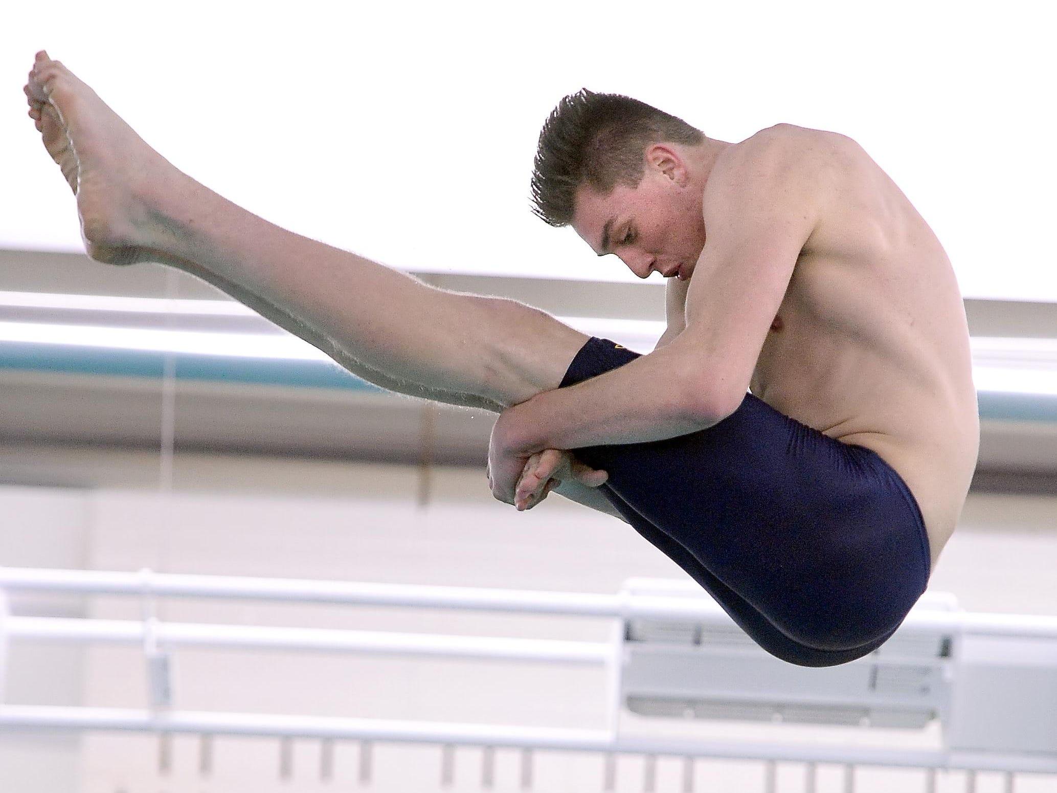 Spencerport's Alex Gunther performs a dive.