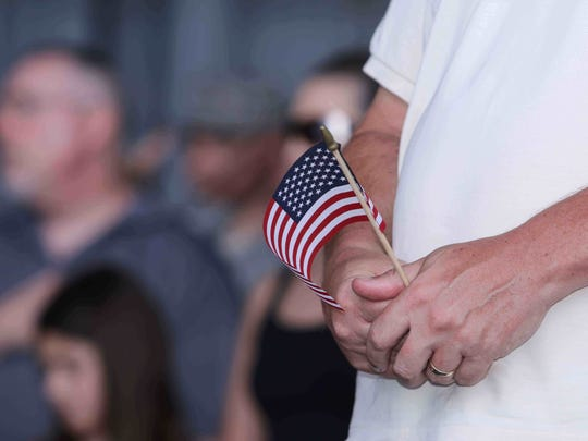 A file photo of a man holding a miniature American flag.