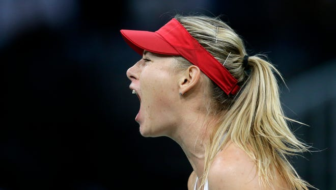 Russia's Maria Sharapova reacts after winning a point against Czech Republic's Karolina Pliskova in their Fed Cup tennis final match between Czech Republic and Russia in Prague, Czech Republic, Saturday, Nov. 14, 2015.