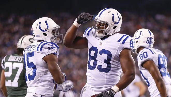 Indianapolis Colts tight end Dwayne Allen (83) celebrates with Phillip Dorsett (15) after catching a 21 yard pass against the New York Jets from quarterback Andrew Luck to score his second touchdown of the first quarter at MetLife Stadium in East Rutherford, N.J., on Monday, Dec. 5, 2016.