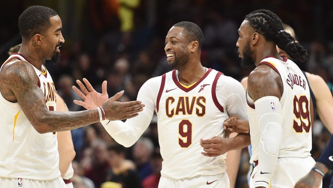 Cleveland Cavaliers guard Dwyane Wade (9) and guard JR Smith (5) celebrate during the second half against the Memphis Grizzlies at Quicken Loans Arena.