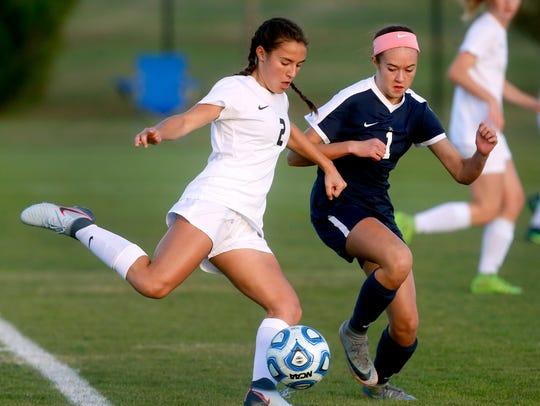 Abbie Rushwin (left) and her Houston soccer teammates will be honored Tuesday for their undefeated season.