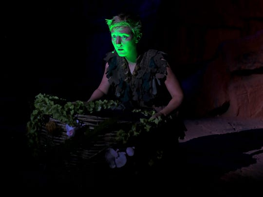 """Tinkerbell's light illuminates the face of Em Grosland, who plays the title role in Tuacahn's 2016 production of """"Peter Pan."""""""