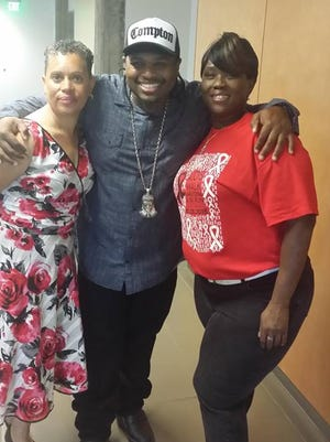 Lorraine Brown (from left), Eric Wright (Lil Eazy E) and Felicia Starks pose at a recent HIV/AIDS breakfast.
