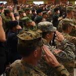 Philippine and U.S. soldiers salute as their national anthems are played during the opening ceremony of the annual joint Balikatan (Shoulder-to-Shoulder) military exercises in Manila on April 4, 2016.