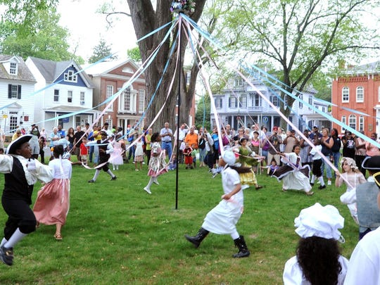Dancers from Sunnyside Elementary school in Smyrna whirl around the Maypole on The Green as part of the Old Dover Days celebration April 2, 2012.