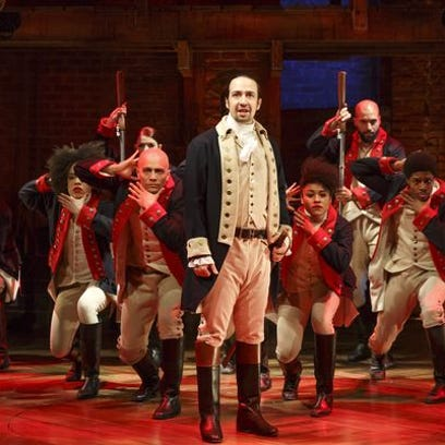 Lin-Manuel Miranda, foreground, with the cast of 'Hamilton,' now the subject of a book written by Miranda and Jeremy McCarter.