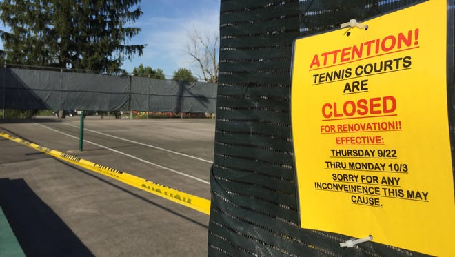 With the contract signed Thursday, work on the Glen Miller Park tennis courts will begin right away. The court improvements are being made possible by Indiana University East and will be branded with the college's Red Wolves mascot.