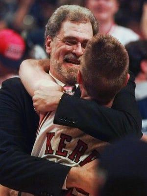 Then-Bulls coach Phil Jackson hugs point guard Steve Kerr after winning the 1997 Finals.