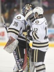 Bears goalie Justin Peters (35) and Nathan Walker (12)