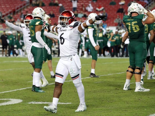 Cincinnati's Perry Young celebrates a missed field goal by South Florida during the second half of an NCAA college football game, Saturday, Nov. 16, 2019, in Tampa, Fla. Cincinnati won 20-17. (AP Photo/Mike Carlson)