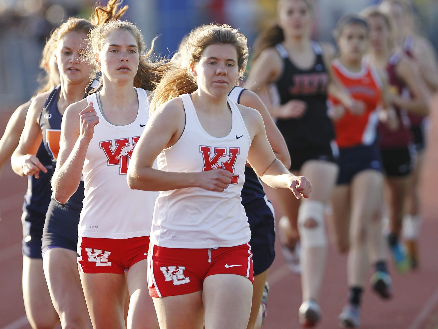 Action from the 800 meter run during the girls track sectional Tuesday, May 19, 2015, at Harrison High School.