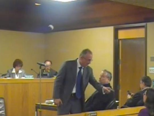 In a screen grab from a video, former Englewood Cliffs Mayor Joseph Parisi is seen scolding Lauren Eastwood at a Borough Council meeting.