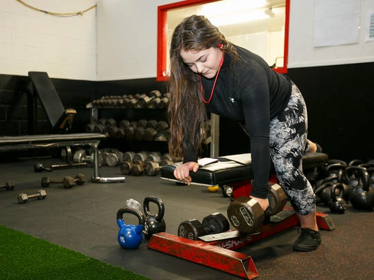Amapola Monteon works with free weights in North Salem High School's newly remodeled weight room on Tuesday, Feb. 14, 2017. Monteon, who is an aspiring body builder, said she didn't know much about weight training until she arrived at North, but her progress has been praised by weight training teacher and baseball coach Chris Lee.