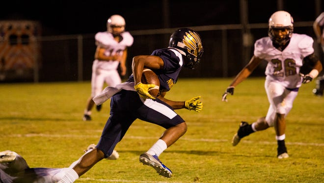 Christopher Taylor, 10, runs the ball during a play against Clarksville.