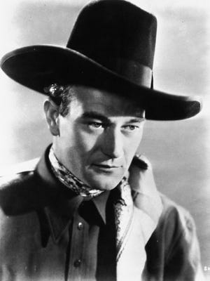 """John Wayne is shown as the Ringo Kid in John Ford's 1939 film, """"Stagecoach."""" He played the hard-boiled rancher Tom Doniphon in Ford's 1962 """"The Man Who Shot Liberty Valance."""""""