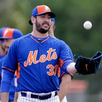 Mets pitcher Matt Harvey tosses a ball to himself during a drill at spring training Thursday.