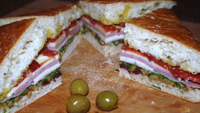 Muffuletta is an easy item for tailgating. A good-sized muffuletta can serve six to eight people.