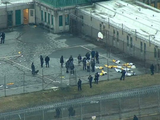 Inmates are contained in the Smyrna prison yard after