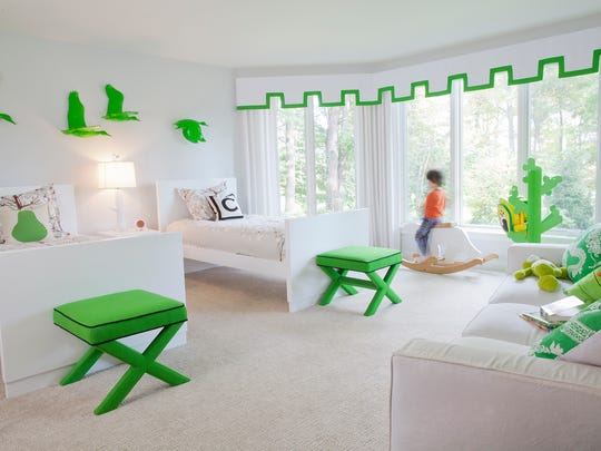 The kids' bedroom makes use of bold color accents.