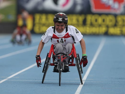 Des Moines East senior Austin Lee pushes to the finish line in the 200-meter wheelchair event on Saturday, May 24, 2014, during the Iowa state high school track and field meet at Drake Stadium in Des Moines.
