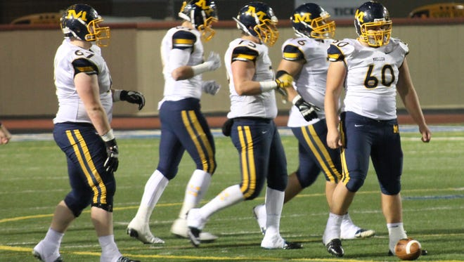 Moeller junior Drew Henke (60) leads the Crusaders' offensive line on the field Nov. 15 against Pickerington Central in the Division I playoffs.