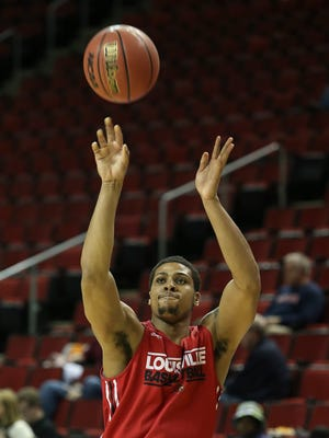 U of L's Wayne Blackshear, #25, shoots during practice at the KeyArena in Seattle ahead of their matchup with UC Irvine in the second round of the NCAA tournament.