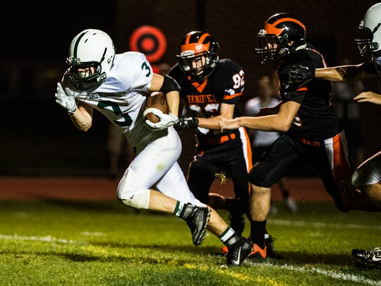 James Buchanan's Owen Stoner breaks from Hanover defense on Friday Sept. 2, 2016 at Sheppard-Myers Stadium in Hanover.