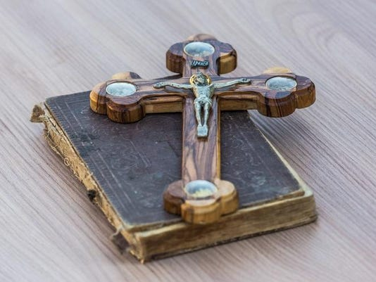 wooden crucifix and the Gospel