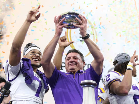 Dec 28, 2019; Atlanta, Georgia, USA; LSU Tigers head coach Ed Orgeron celebrates with safety Grant Delpit (left) and wide receiver Justin Jefferson (2) after defeating the Oklahoma Sooners in the 2019 Peach Bowl college football playoff semifinal game at Mercedes-Benz Stadium. Mandatory Credit: Brett Davis-USA TODAY Sports