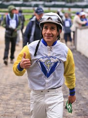 Jockey Paco Lopez gives a thumbs up after a spectator