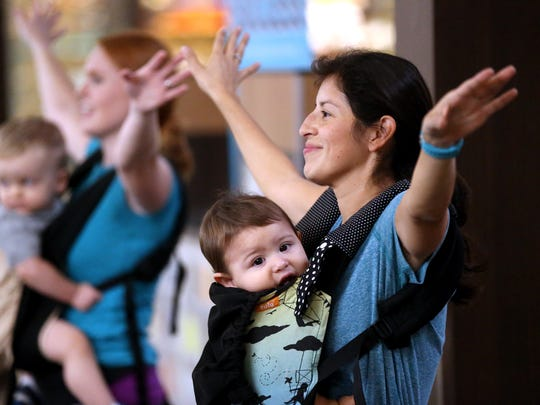 Christy Solis dances with her son Maximus during The Mommy & Me Fitness Club on Tuesday, Jan. 3, 2017, at La Palmera mall in Corpus Christi.