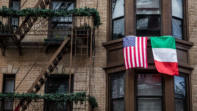 Exterior of a building facade in Mulberry Street, Little Italy, NYC, USA, displaying an American National Flag and an Italian national Flag