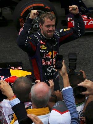 Sebastian Vettel celebrates after winning the Brazilian Grand Prix.