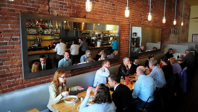 Diners enjoy lunch at Kitchen on Court Street. The restaurant has expanded its breakfast menu and is now serving breakfast all day.