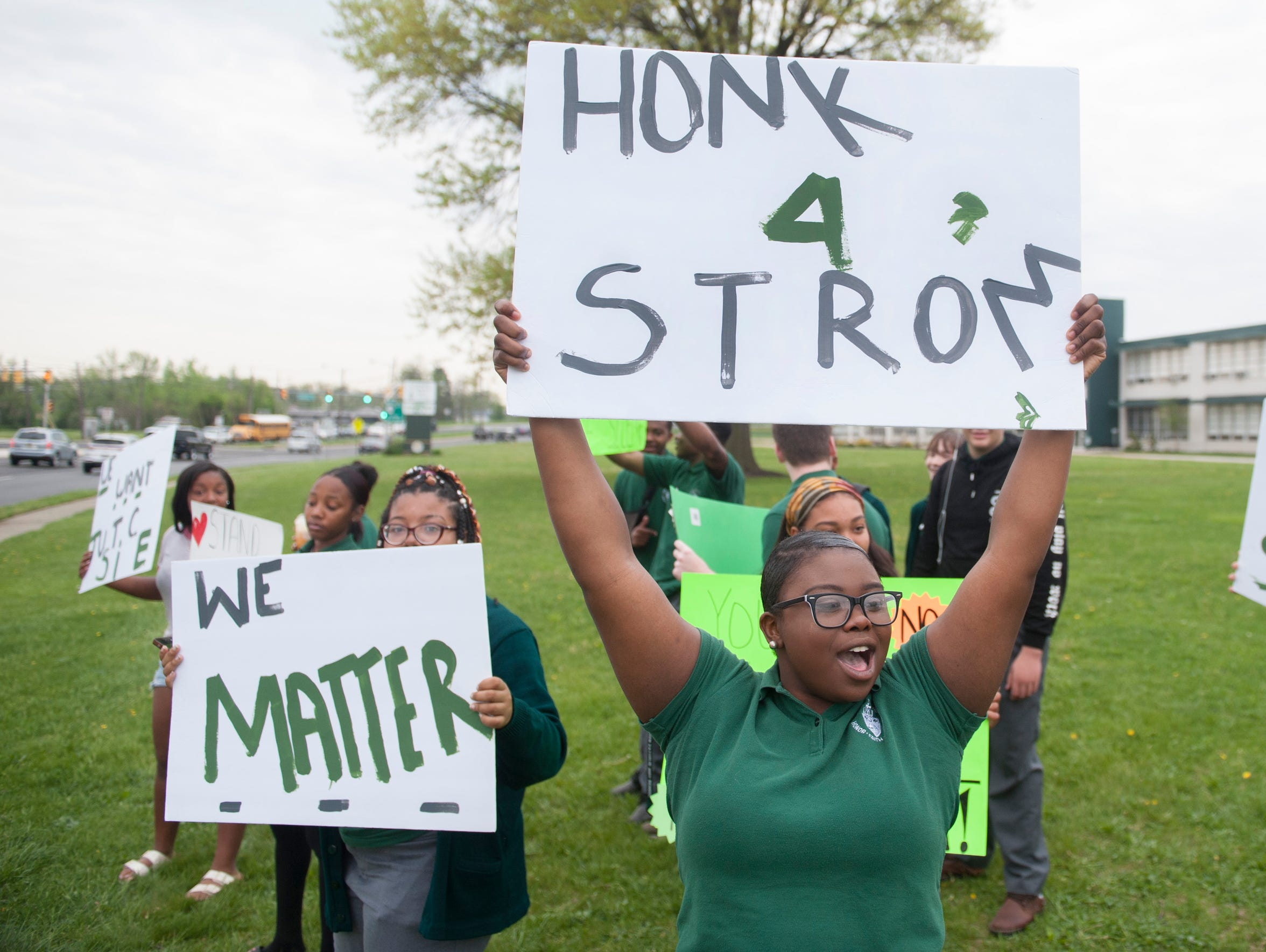 Students rally in front of Camden Catholic High School in May to support former football coach Nick Strom.