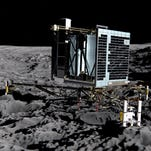 This Nov. 12, 2014, image relased by the German space agency DLR on July 30, 2015, show the Philae lander 221 feet above the comet surface as it descends. The probe bounced after touchdown and came to rest two hours later on an angle in the shadow of a cliff.