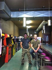 Sean Newton (left) and CJ Nelson keep Salem entertained at their barcade.