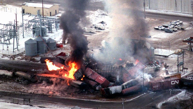 A Wisconsin Central Ltd. freight train derailment and fire forces the evacuation of the entire city of Weyauwega and much of the surrounding area on March 4, 1996.