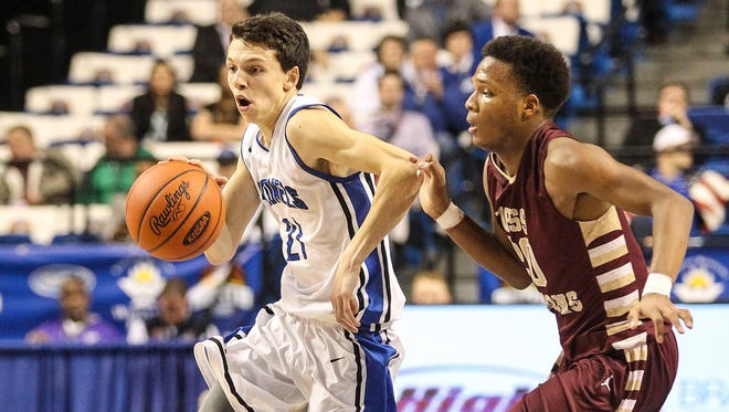 Cooper Theobald drives the ball past Doss' Nick Anderson during the second quarter of their quarterfinal game in the Boys Sweet Sixteen at Rupp Arena in Lexington, Friday, March 20, 2015.