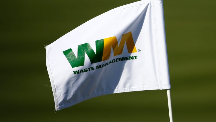 A Waste Management flag flies during the second round of the Waste Management Phoenix Open at TPC Scottsdale on Friday, February 5, 2016.