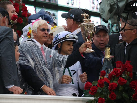 Justify trainer Bob Baffert celebrates in the winner's